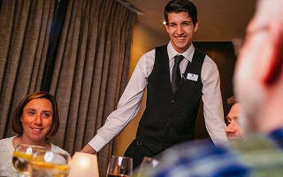 waiter with guests at luxury norfolk hotel